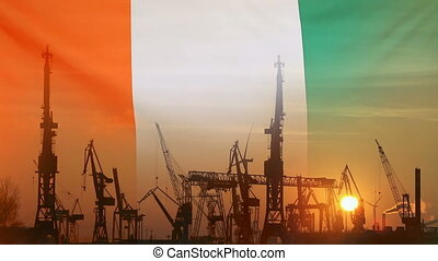 Industrial concept with Ivory Coast flag at sunset