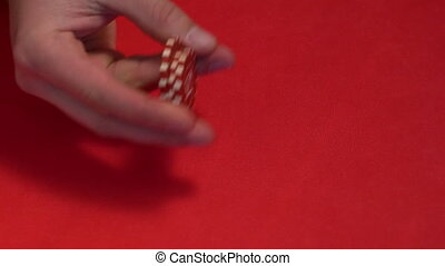 Croupier makes trick with chips. - Croupier makes trick with...
