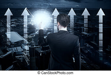 Technology concept - Back view of young businessman pressing...