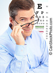 Man - Mature smiling man with  eyeglasses and eyechart