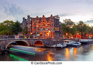 Amsterdam. City Canal at night. - A view of the picturesque...