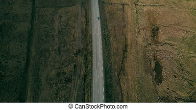 Aerial view of the beautiful landscape. Cars riding on the...
