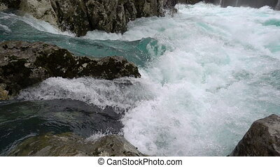 a fast-moving stream of the mountain river, slow motion