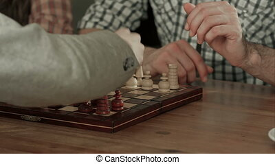 Two men play chess. Close up. Professional shot in 4K...