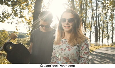 Hipsters Couple Against Sunset - Young blonde sexy teenager...