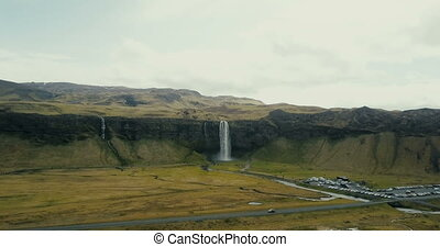 Copter approaches to the powerful waterfall Seljalandsfoss...
