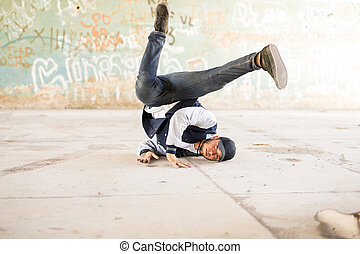 Breakdancer doing a headstand - Portrait of an attractive...