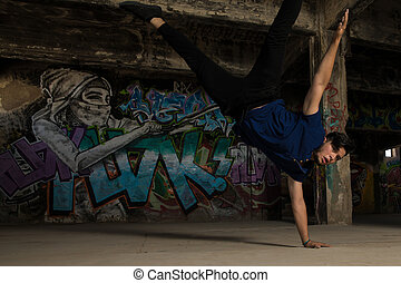 Young male dancer doing a handstand