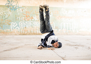 Male dancer doing a headstand