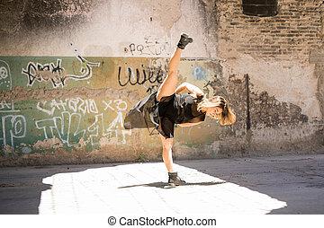 Contempo dancer doing a leg split - Wide view of a pretty...