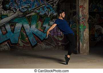 Young man performing a dance routine