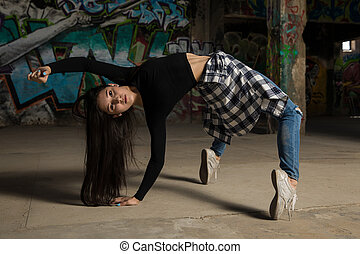 Female dancer tiptoeing and bending - Portrait of a pretty...