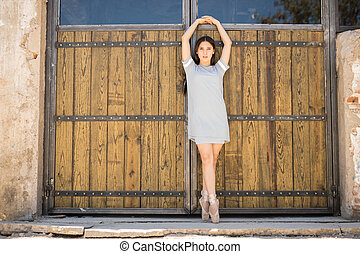 Young ballerina performing outdoors - Gorgeous ballet dancer...