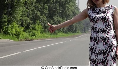 beautiful woman catching car on a road