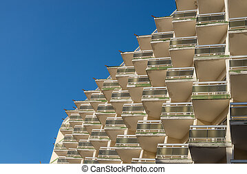 Balconies - Many small balconies on a large residential...