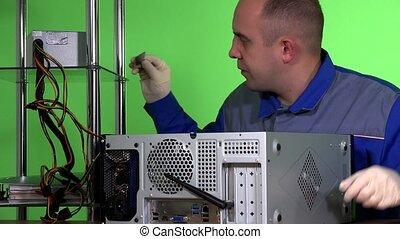 IT support engineer guy changes desktop computer RAM memory....