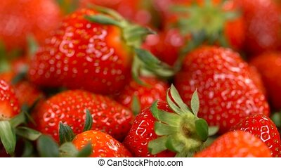 rotating background of strawberry, close up, seamless...