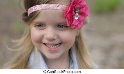 Cheerful girl in a summer park - Hippie girl with flowing...