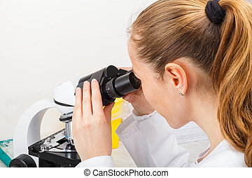 Scientist working in laboratory - Photo of young scientist...