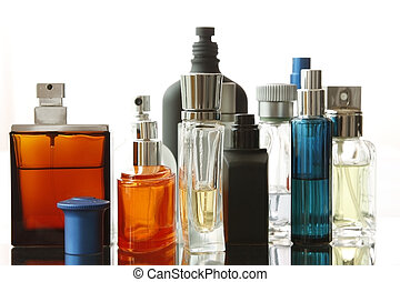Assorted Perfume Bottles in a white background with...