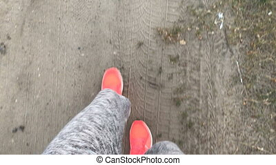 girl walks in pink sneakers on Earth top view