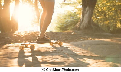 Teenager with Board - Evening sundown shot low section of...