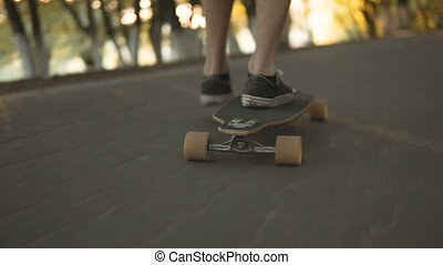 Teenager with Board - Low section of teenager boy riding...
