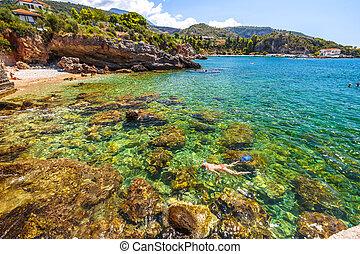 Snorkeling in Mani Greece - Woman snorkeling in Foneas...