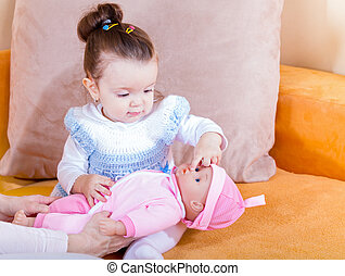 Adorable baby girl - Photo of adorable baby playing with the...