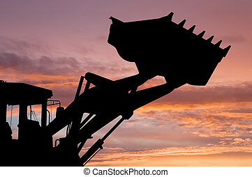 loader shovel silhouette - silhouette of risen loader...