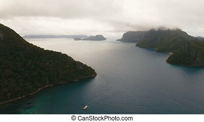 The beautiful bay with mountains rocks aerial view. Tropical...