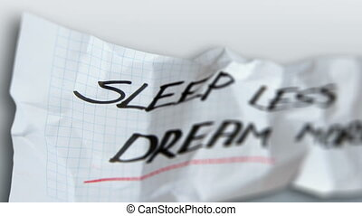 Sleep less and dream more words on torn paper
