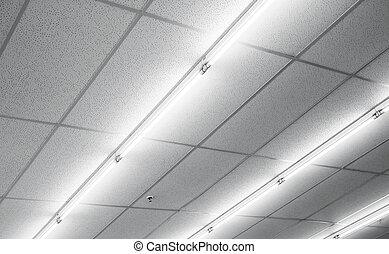 Warm white fluorescent or neon light on ceiling