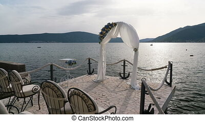 Arch for a wedding ceremony near the sea, time lapse