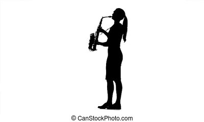 Musician woman playing on saxophone. Black silhouette on...