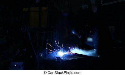 Arc welder with welding sparks. - Flashes and lot of sparks...