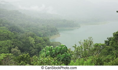 Panoramic view of the Lake Tamblingan in fog of Bali...