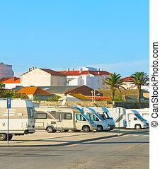 Caravan car parking - Caravan parking full of cars at sunset