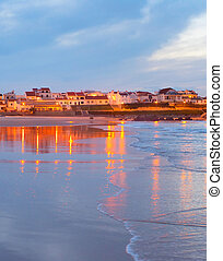 Coastal town at dusk. Portugal - Town on the ocean shore...