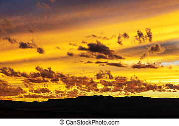 Sunset background - Unusual storm clouds at sunset. Bright...