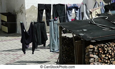 Hanging clothes on the yard after been washed