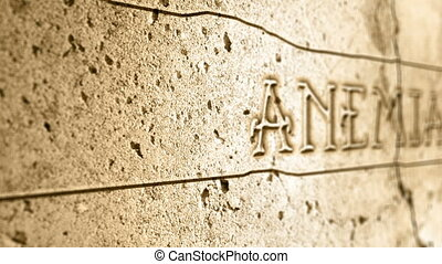 word anemia on wall with egyptian alphabet