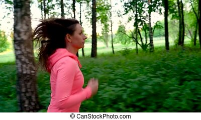Woman runs through the forest, slow motion - Young woman...