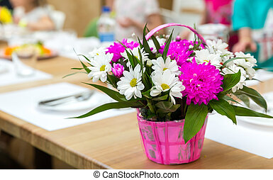 Fresh flower bouquet decorated with basket. Floral...