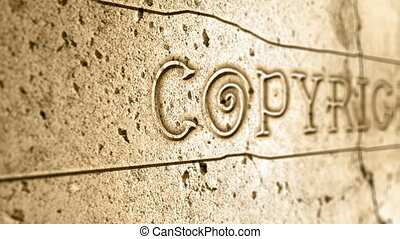 word copyright on wall with egyptian alphabet