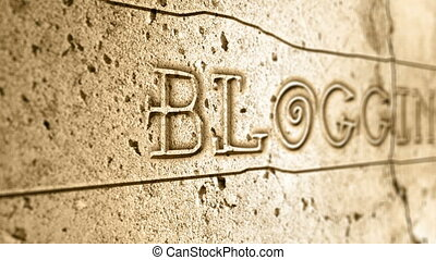 word blogging on wall with egyptian alphabet