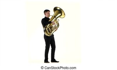 Man plays on the tuba slow melody in white background - Man...