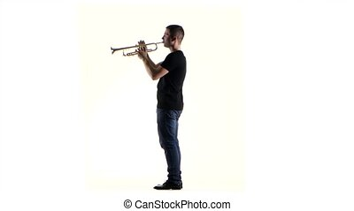 Man trumpeter blows the motif in wind instrument. White...
