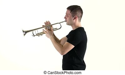 Young musician playing on pipe standing sideways on white...