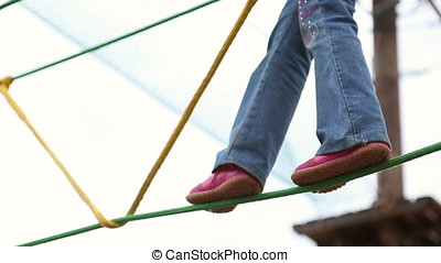 Girl overcomes a challenging obstacle course, entertainment...